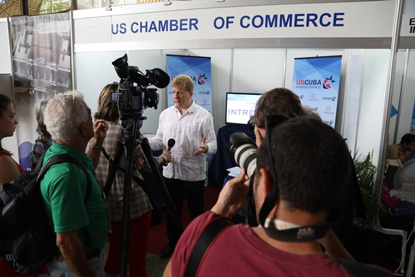 Myron Brilliant chats with press during a delegation visit to Cuba