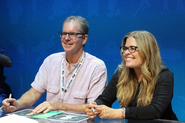 The directors of Frozen Fever, Chris Buck and Jennifer Lee, signing lithographs of the film's visual development art at D23 Expo in Anaheim, California on August 16, 2015.